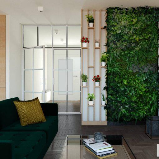 Projekt wnętrz strefy dziennej z nowoczesnym regałem na kwaity i fragment zielonej,roślinnej ściany, z sofą vintage w kolorze butelkowej zieleni i regałem RTV ze sklejki
