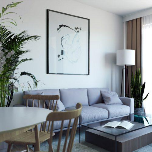 salon w duchu slow z jasną kanpą i dużą ilością roślin zielonych